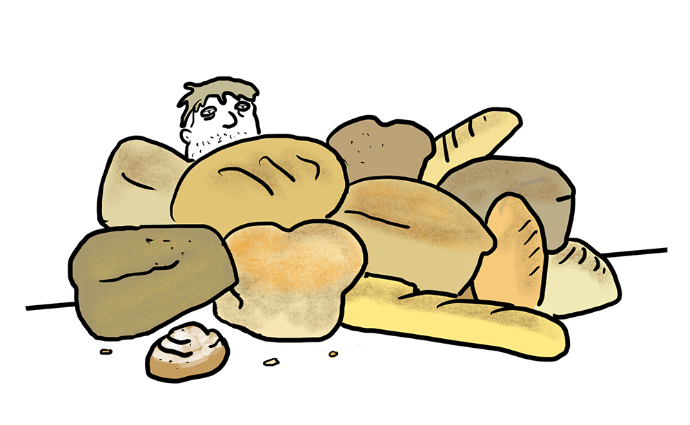 Several loaves of bread on a white background and, if you look closely you can see Nick Gatlin peering over the pile o' bread.